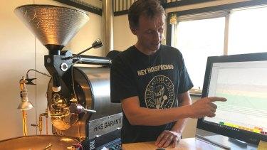 Brad Bradshaw using roasting software to perfect his coffee batch.