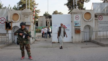 An Afghan National Army soldier stands guard at the gate of the Kunduz MSF hospital earlier this month.
