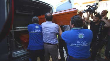 Officials carry the coffin of Rehan Kurdi, the mother of Syrian boys Aylan and Galip from a morgue to a funeral car in Mugla, Turkey.