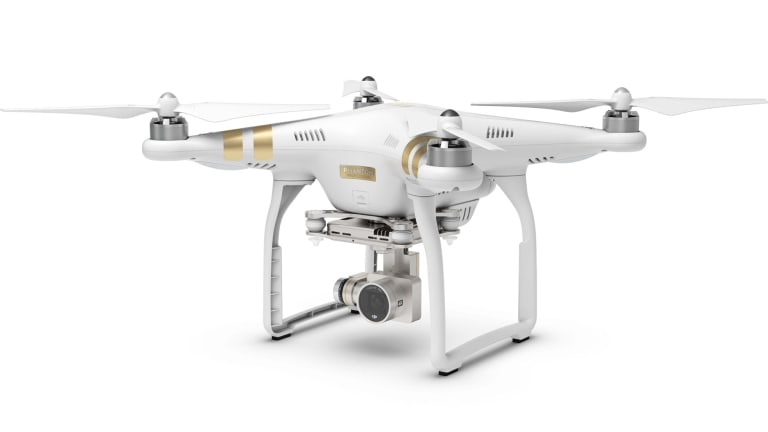A consumer-model drone with a camera attached.