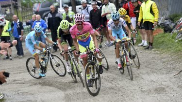 Tinkoff-Saxo's Alberto Contador leads his group up the dirt track of Colle delle Finestre during the penultimate stage of the Giro d'Italia on Saturday.