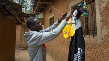 Jean-Eric Habimana hangs his cycling kit on the line outside his house in Rwanda.