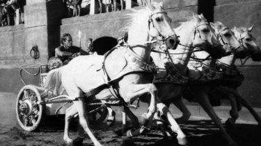 Charlton Heston drives his chariot towards the finish line in the 1959 <i>Ben-Hur</i>.