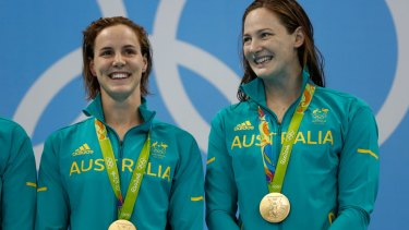 Golden pair: Bronte and Cate Campbell pose with their 4x100m freestyle relay medals.