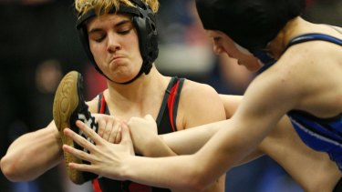 Euless Trinity's Mack Beggs, left, wrestles Grand Prairie's Kailyn Clay during the finals of the UIL Region 2-6A wrestling tournament in Allen.