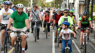 Cyclists ride along Sydney Road in a tribute to Alberto Paulon who was killed in a dooring incident one year ago on the road.