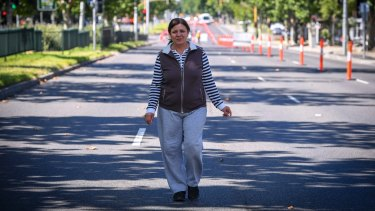 .Collingwood resident Nuray Benek took a walk down a deserted Hoddle Street.