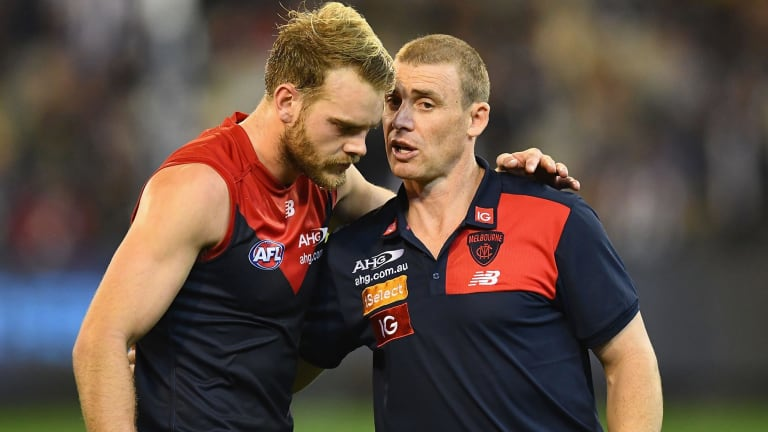Jack Watts of the Demons talks to Demons head coach Simon Goodwin during their win over the Pies on Queen's Birthday.