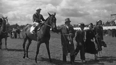 Edgar Britt on Musidona, being led in by owner N Donaldson, after winning the Oaks Stakes, 1949.