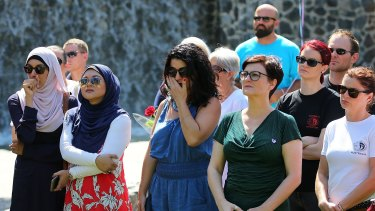 People attend the official unveiling of Brisbane's first domestic violence memorial.