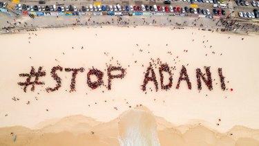 Organisers estimated 1500 people gathered on Bondi Beach on Saturday to protest the Adani mine.