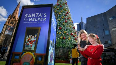 Georgina Way and her daughter Phoebe from the Mornington Peninsula try out the Santa's Lil Helper app.