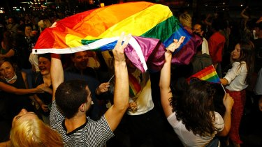 Supporters of same-sex marriage are seen celebrating at a street party and march in Sydney.