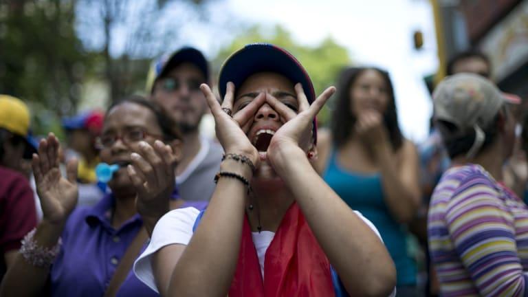 A demonstrator shouts against Venezuela's President Nicolas Maduro in Caracas.