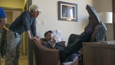 Ed Solomon, standing, and Steven Soderbergh on the set.