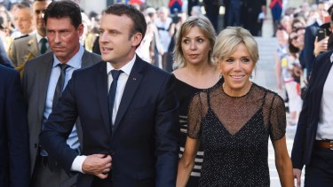 France's President Emmanuel Macron, left, and his wife Brigitte Macron awaiting Colombia's President Juan Manuel Santos and his wife Maria Clemencia Rodriguez for a dinner at the Elysee Palace in Paris, France, Wednesday, June 21, 2017.
