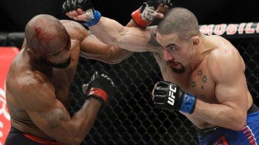 True blue: Australian Robert Whittaker has won the UFC interim middleweight title with a thrilling unanimous points win against Cuban Yoel Romero in Las Vegas.