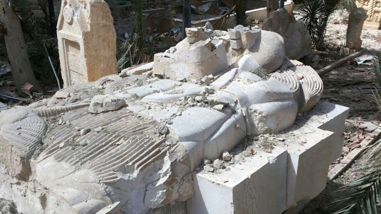 A destroyed statue outside the damaged Palmyra Museum.