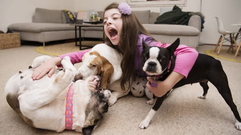 India Brewer with her three dogs, all vegan.