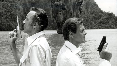 James Bond (Roger Moore, right) duels with Christopher Lee in <i>The Man with the Golden Gun</i> at Khao Phing-Kan island, Thailand.