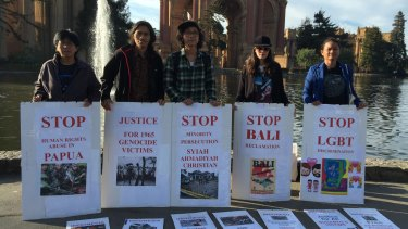 Protesters outside the Palace of Fine ArtsTheatre in San Francisco on Tuesday called on President Joko Widodo to address human rights.