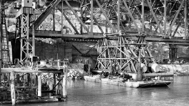 Each of the steel spans was constructed on the southern bank, where a ledge was cut out of a sandstone cliff face