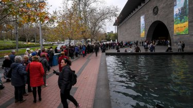 Crowds wait outside the NGV.