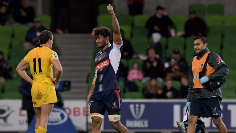 Amanaki Mafi (centre) has re-signed with the Melbourne Rebels.