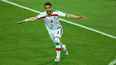 Iran's Ehsan Haji Safi celebrates after he scored his side's first goal against Bahrain on Sunday.