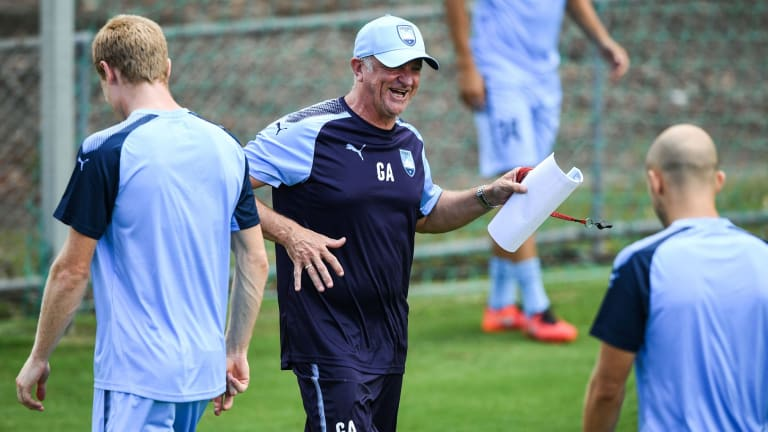 Sydney FC coach Graham Arnold smiles during team training at Macquarie University on Tuesday.