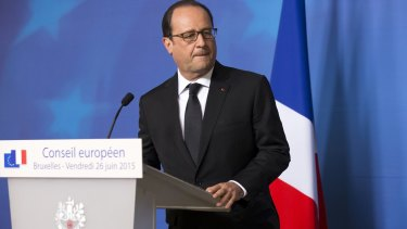 """The attack is terrorist in nature"": French President Francois Hollande gives a statement at the European Council headquarters."