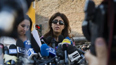 Francesca Chaouqui talks to journalists on Thursday after her conviction by a Vatican court.