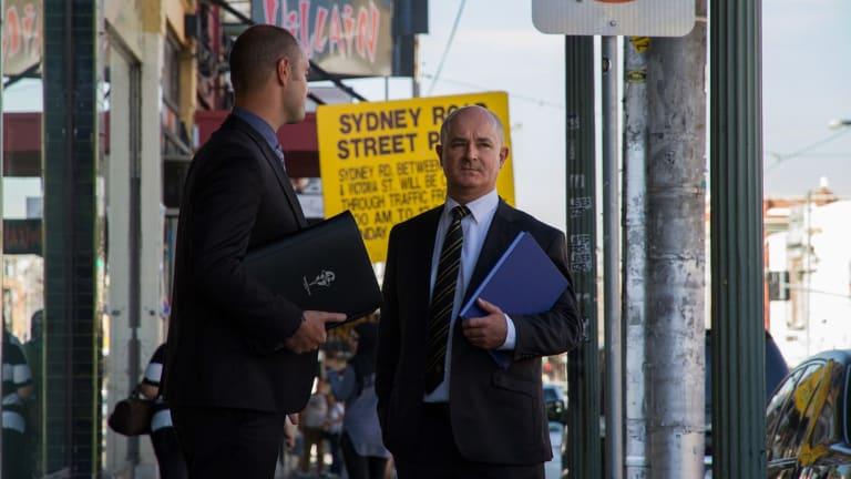 Homicide detectives Paul Rowe, left, and David Butler on Sydney Road, Brunswick.