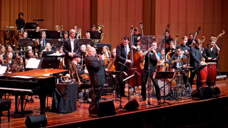 James Morrison, standing centre left, Zach Raffan, standing centre right, soloists and the Canberra Youth Orchestra perform at Llewellyn Hall.
