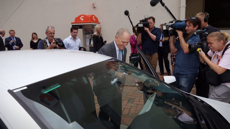 Communications Minister Malcolm Turnbull surrounded by media after touring the Queanbeyan Telstra exchange on Wednesday.