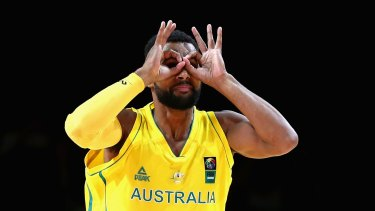 Three goggles: Patty Mills celebrates in his own inimitable style after scoring against New Zealand.