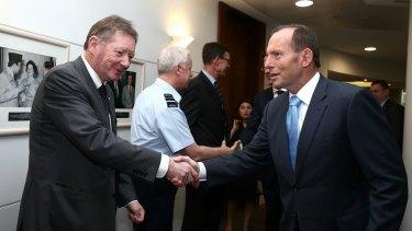 Dr Watt greets then Prime Minister Tony Abbott in 2014.