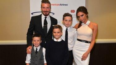 Still strong: David Beckham with wife Victoria Beckham and sons (L-R) Cruz, Romeo and Brooklyn Beckham.