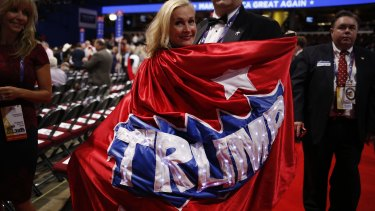 My hero: a delegate wears a Trump cape on the convention floor.