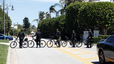 Sheriff's deputies block the street as Donald Trump and Xi Jinping meet at Mar-a-Lago.