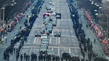 The motorcade carrying President Barack Obama and President-elect Donald Trump down Pennsylvania Avenue.
