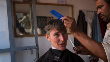"""Ayres at a barber's shop in central Afghanistan:  his first outwardly """"male"""" activity in a  country with extreme gender segregation."""