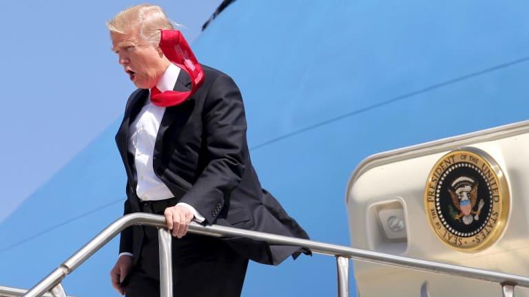 All tied up: President Donald Trump arrives at Orlando International Airport on Friday.