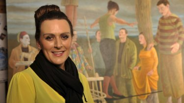 Museum curator Bianca Acimovic pictured with the oil on canvas work Saltimbanques 2007 by Australian artist Graeme Drendel.