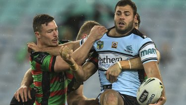 Looking for support: Wade Graham tries to offload during the round 24 NRL match between the South Sydney Rabbitohs and the Cronulla Sharks at ANZ Stadium.