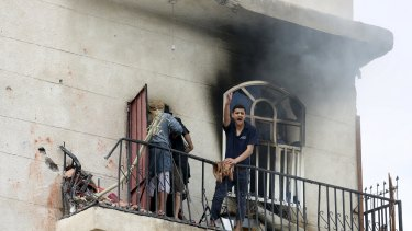 A man reacts at the site of an air strike in the Yemeni capital Sanaa on April 8.