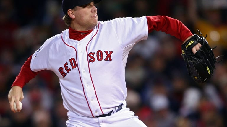 Curt Schilling pitches for the Boston Red Sox during the 2007 Major League Baseball World Series at Fenway Park.
