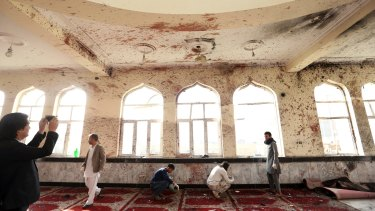 Suicide bombers struck two mosques in Afghanistan during Friday prayers, the Shiite mosque in Kabul and a Sunni mosque in western Ghor province at the end of a particularly deadly week for the troubled nation.