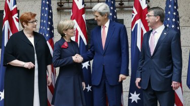 US Secretary of State John Kerry shakes hands with Australian Foreign Minister Julie Bishop, left, with Defence Secretary Ash Carter, right, and Australian Defence Minister Marise Payne, left, in Boston on Tuesday.