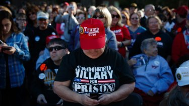 A Trump supporter wears a 'Crooked Hillary for prison' T-shirt  at a rally at Regent University, Virginia Beach.